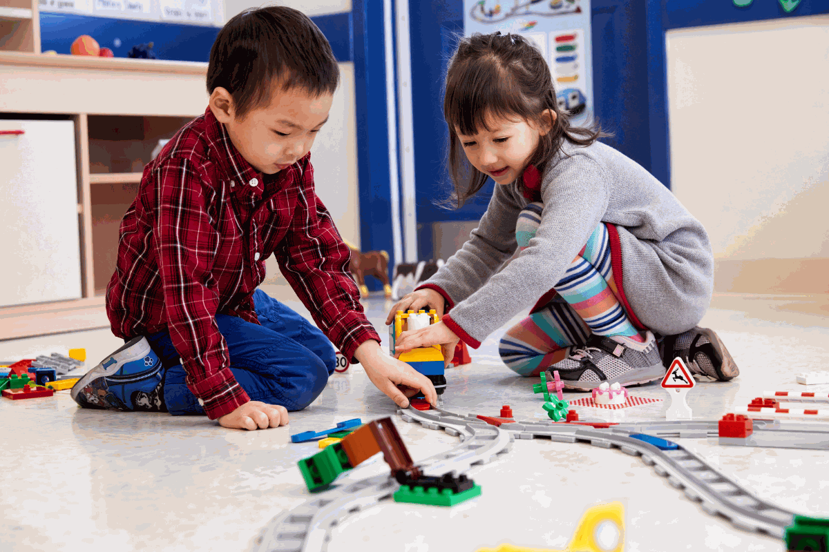 Children using lego education kits to build a train and learn how to code