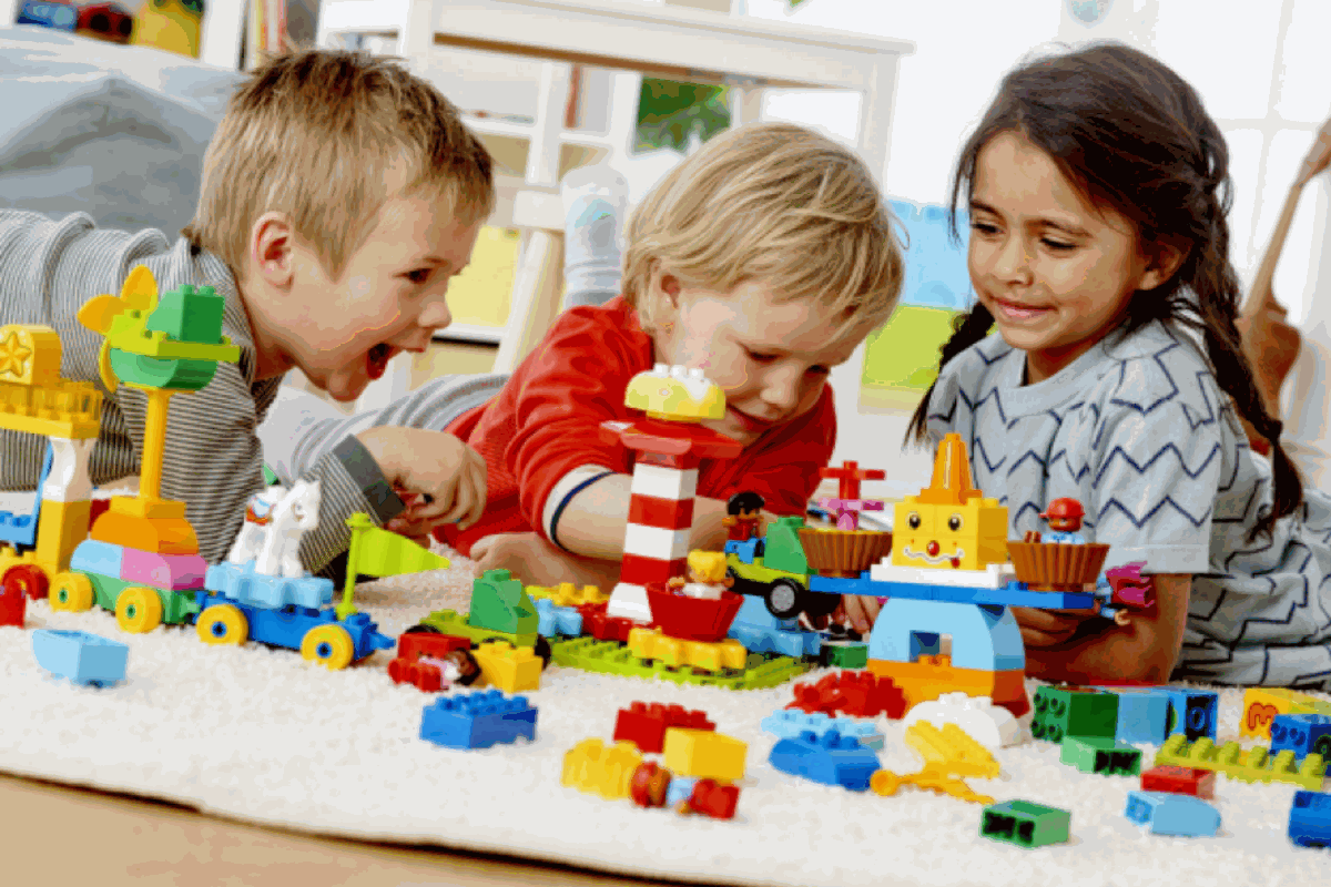 Children building a themed park with lego education bricks to learn how to code