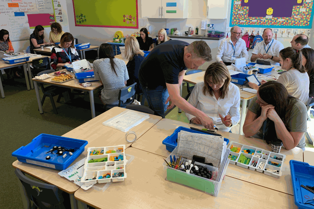 Certified trainer during a lego education workshop showing teachers how to use lego kits